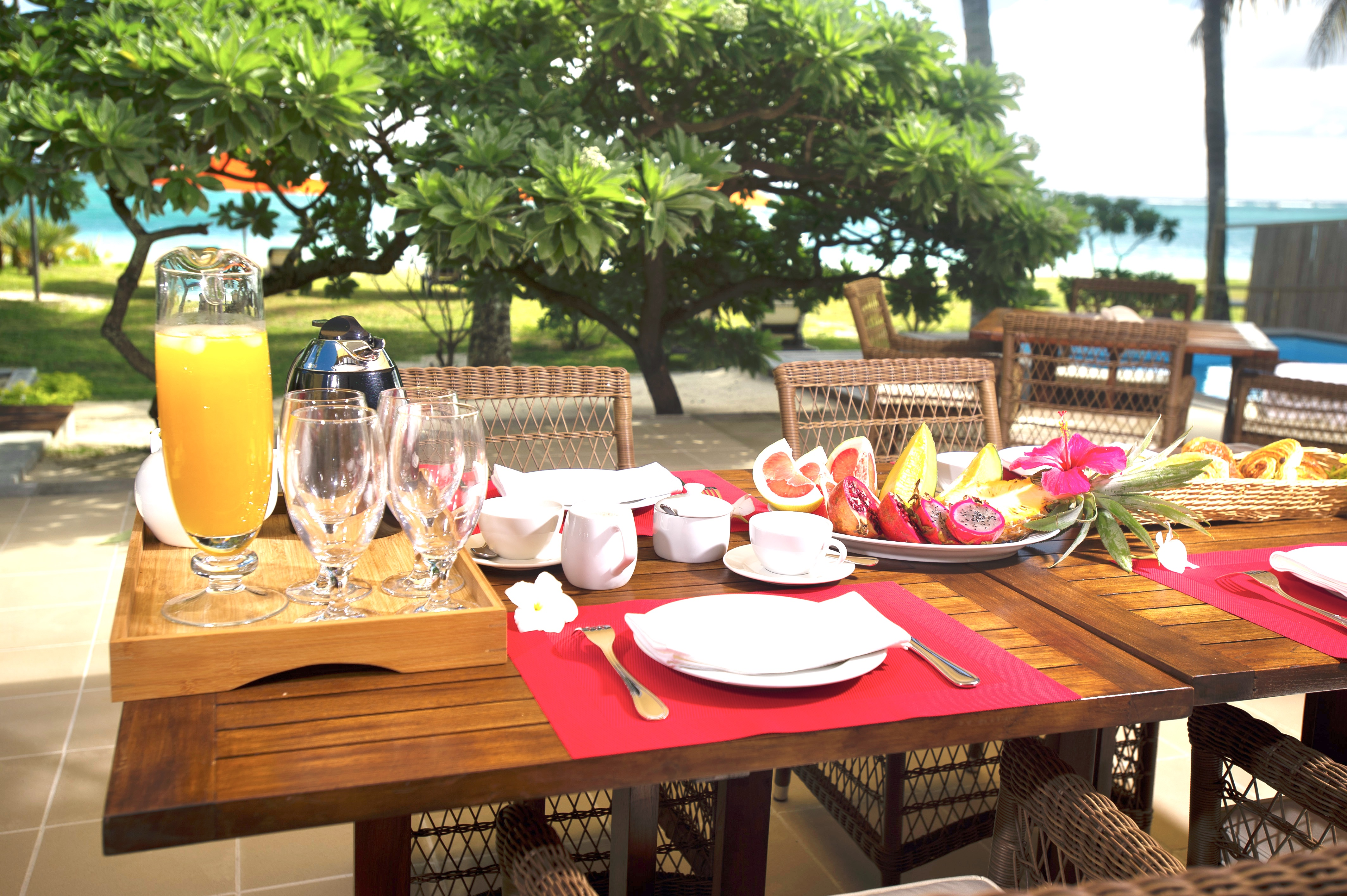 dining table outside terrace pool