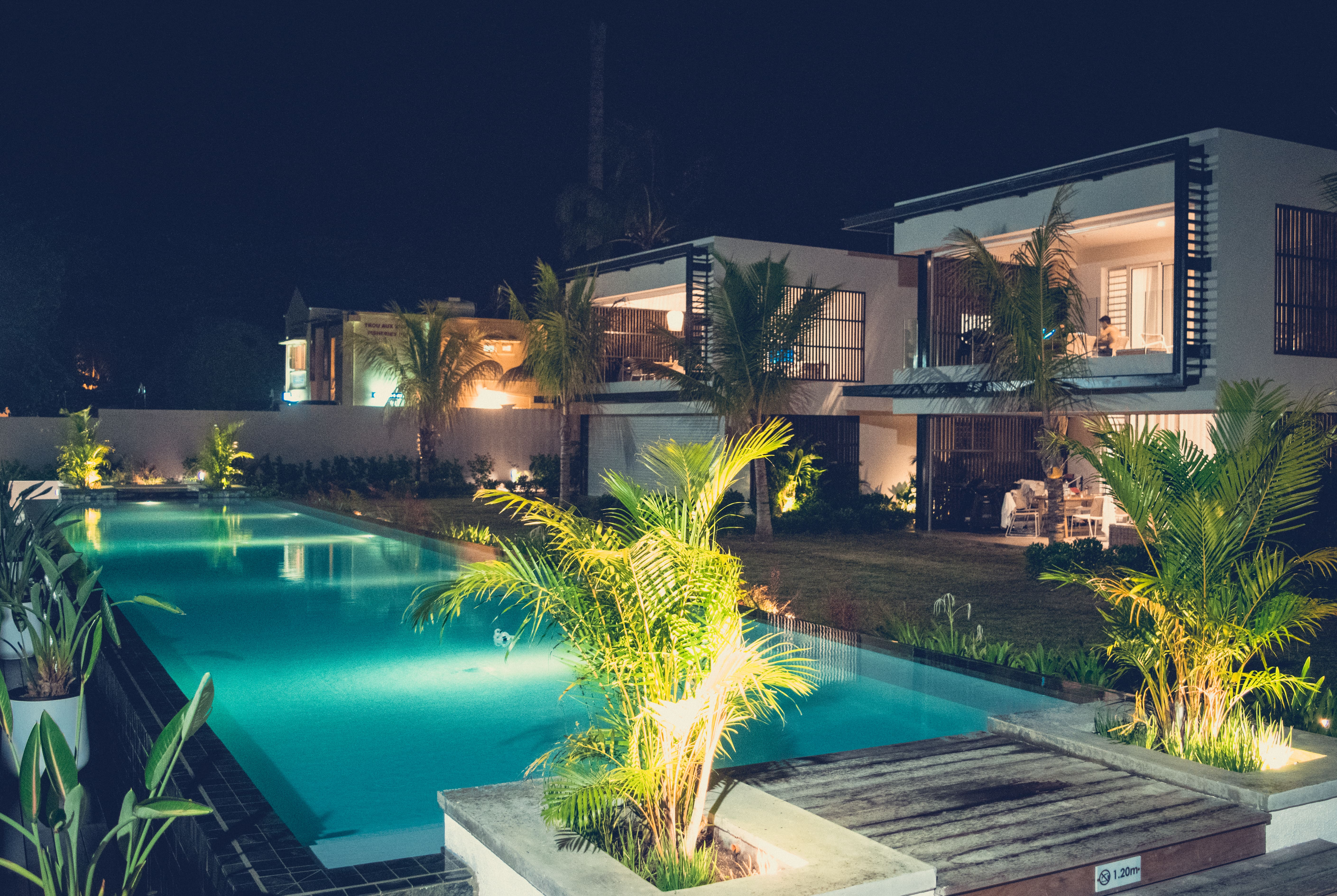 Deluxe Apartment Trou aux Biches pool by night